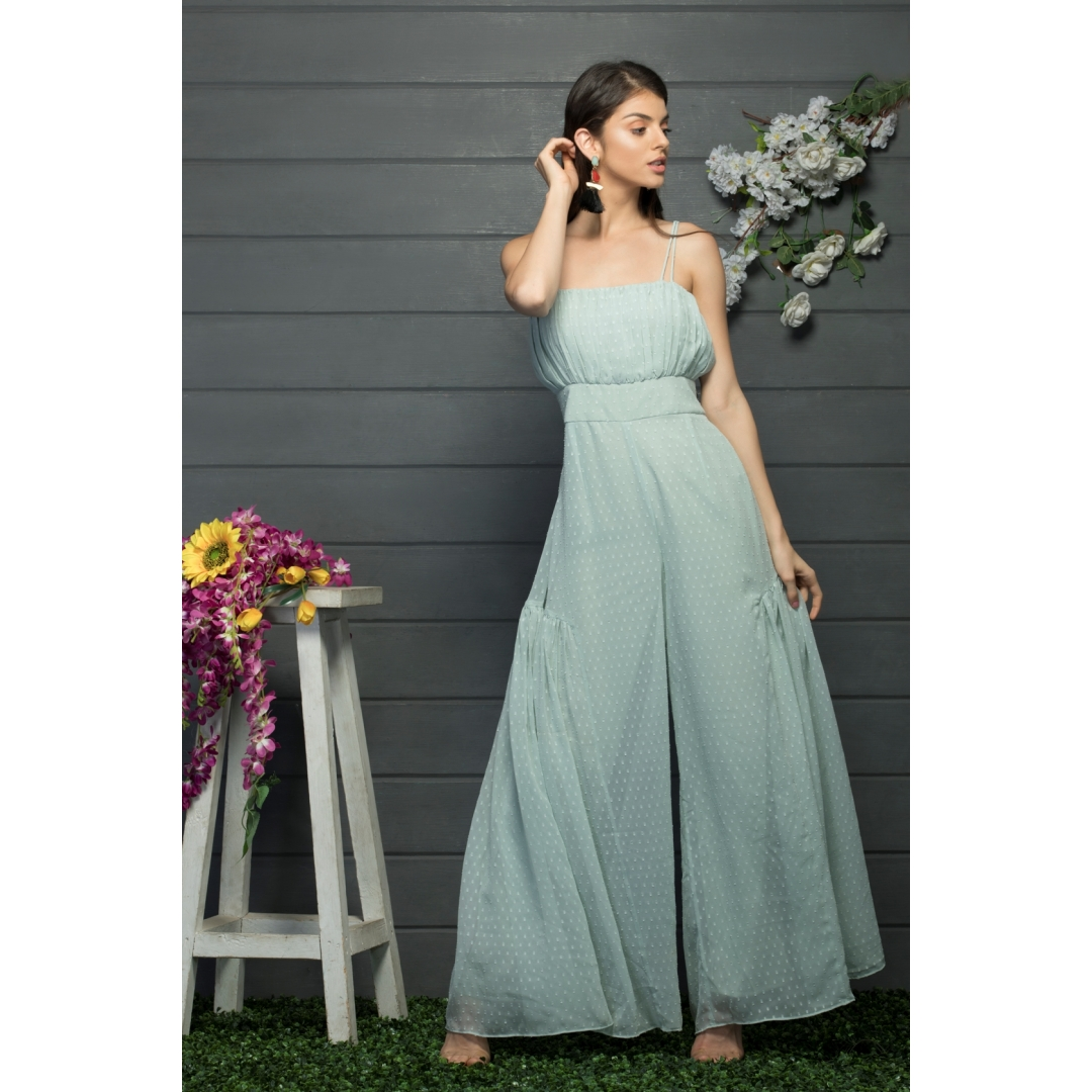 Flared jumpsuit with ruching at the bust area