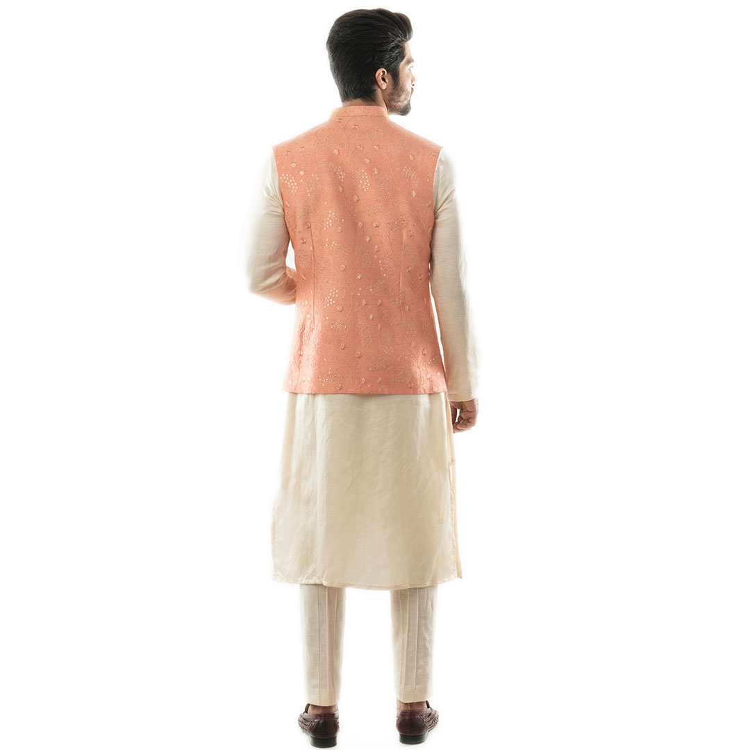 A Peach Nehru with Overall Tonal Embroidery, Highlighted With Sequins. Paired with a Double Panel Ku