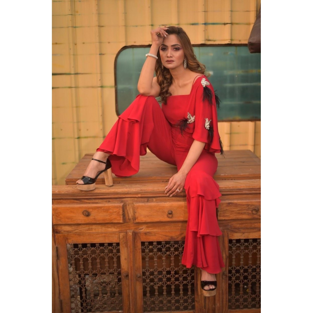 ONE SHOULDER CAPE JUMPSUIT WITH FEATHER DETAILING EMBROIDERY AND LAYERED BOTTOM