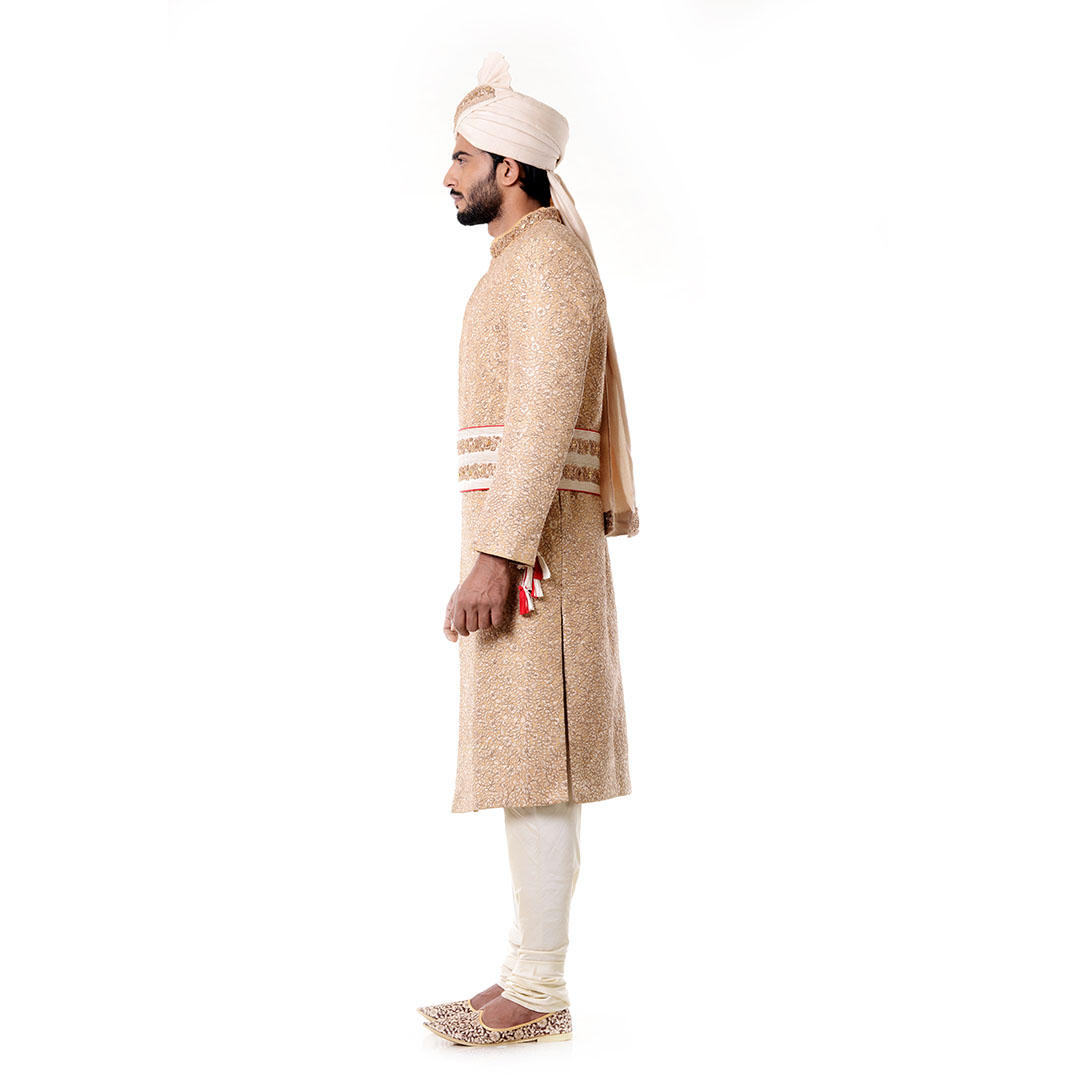 Cream Kurta with Zadi Embroidered Beige Sherwani set.