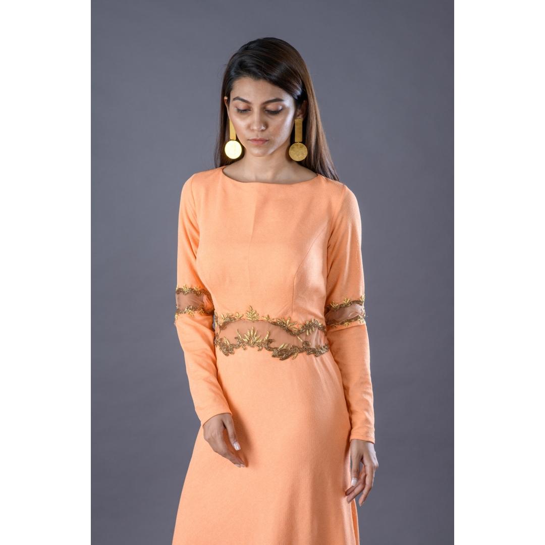Orange gown with zardosi handwork on waist and elbow