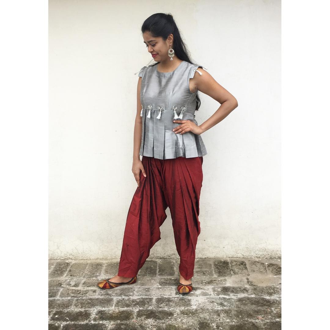 THE INDO PLEATED PEPLUM DRESS