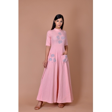 pink maxi with blue flower print on bodice and pockets