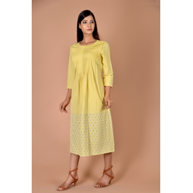 yellow pleated frock with blue small flower print on bottom
