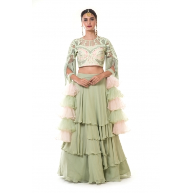Green Layered Skirt with Heavy Hand Embroidered Blouse with Fringes and Ruffle Net Dupatta