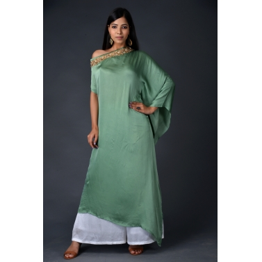 Green modal asymmetric drape top paired with off white pallazos