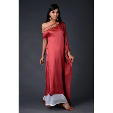Red modal asymmetric drape top paired with off white Palazzo