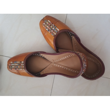 yellow brown leather jutti with multicolor lace work