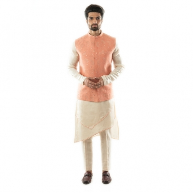 A  Peach Nehru with Overall Tonal Embroidery, Highlighted With Sequins.