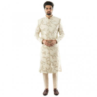 Cream Leaf All Over Jaal Hand Embroidered Sherwani paired with a Cream Pin-tuck Pant Pajama