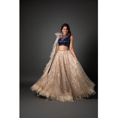 Navy blue sequined blouse with multi-coloured sequined beige lehenga and ruffle dupatta