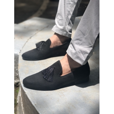 black suede tasseled loafers